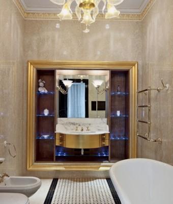 Стены гостиной, столовой и кухни, а также колонны декорированы буазери из эбенового дерева. Буазери, покрытые несколькими слоямилака до достижения зеркального блеска, были сделаны по специальному заказу на фабрике Francesco Molon.  Парадный интерьер в стиле ар-деко – Елена Белкова                          2 7 340x400
