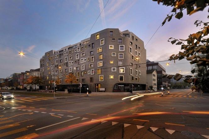 Архитектурное бюро Camenzind Evolution в плотном сотрудничестве со своим клиентом, компанией Swiss Life, создали уникальный проект жилого комплекса на 45 индивидуальных квартир. Основной задачей было разработать квартиры, которые бы обладали индивидуальностью  Жилой Дом с Нескучными Фасадами от Camenzind Evolution                                                                 Camenzind Evolution 6