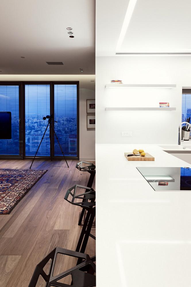Проектное бюро GammaArc Group представило проект TLV Apartments3 Современные апартаменты площадью 150 кв метров расположены на 22 этаже одной из высоток в Тель-Авиве  Апартаменты в Тель-Авиве от GammaArc Group                                                    GammaArc Group 4